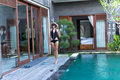 Young Woman In Swimsuit In Swimming Pool In Gorgeous Resort, Luxury Villa, Tropical Bali Island, Indonesia. Royalty Free Stock Photo - 91037585