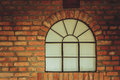 Big Rounded Window On Red Brick Wall Stock Photography - 91045182