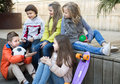 Group Of Children Sitting On Wooden Scaffolding Schoolyard Stock Image - 91048791