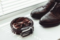 Brown Bow Tie, Leather Shoes And Belt. Grooms Wedding Morning. Close Up Of Modern Man Accessories Royalty Free Stock Photo - 91050665