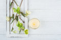 Green Flowers And Lit Candle Stock Photography - 91061422
