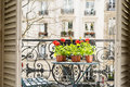 Springtime With Red Geraniums On A Balcony In Paris, France Royalty Free Stock Image - 91083486