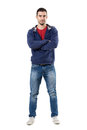 Smiling Friendly Man In Hooded Blue Shirt With Crossed Arms Looking At Camera. Stock Photography - 91113122