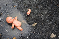 Abandoned Baby Doll In The Water On The Road, Concept For Sad Emotion, Thriller, Departed Stock Photos - 91113253