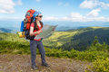 Hiker With Map Stock Images - 91114694