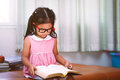Child Asian Little Girl Put On Eyeglasses Reading A Book Royalty Free Stock Photo - 91172825