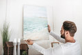 Bearded Man Hanging Picture On Wall At Home Stock Photography - 91173082