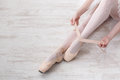 Ballerina Puts On Pointe Ballet Shoes, Graceful Legs Stock Images - 91180584