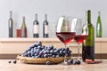 Bottle And Glasses Of Red Wine On The Kitchen Table Royalty Free Stock Photography - 91188857