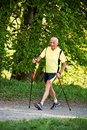 Elderly Man With Nordic Walking Royalty Free Stock Photography - 9126707