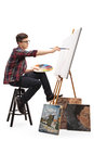 Teenage Painter Painting On A Canvas With A Paintbrush Stock Image - 91206461