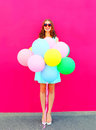 Happy Smiling Young Woman With An Air Colorful Balloons Having Fun In Summer Over A Pink Background Royalty Free Stock Images - 91212509