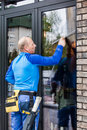 Window Washer Working  At Building Outdoor Stock Image - 91219401