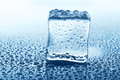 Transparent Ice Cube With Reflection On Blue Glass With Water Drops Royalty Free Stock Images - 91239339