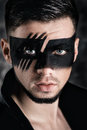 Fantasy Art Makeup. Man With Black Painted Mask On Face. Close Up Portrait. Professional Fashion Makeup. Royalty Free Stock Photography - 91242837