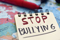 Text Stop Bullying In A Notebook Stock Photo - 91247100