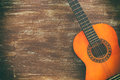 Close Up Of Acoustic Guitar Against A Wooden Background Stock Photography - 91251942