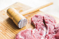 Fresh Red Meat And A Hammer For Beating Meat Royalty Free Stock Image - 91252636