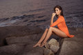 Pretty Woman On The Rocks Royalty Free Stock Image - 91274466