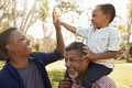 Grandfather With Son And Grandson Having Fun In Park Stock Photos - 91276453