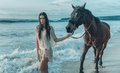 Brunette Lady Walking With A Horse Stock Photos - 91282463