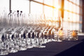 Empty Wine Glasses In The Row In The Bar Before Evening Party And Dinner Stock Photo - 91293380