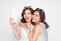 Portrait Of Two Beautiful Asian Fashionable Women Taking Selfie Royalty Free Stock Images - 91310859