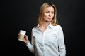 Attractive Young Woman Enjoying Cup Of Coffee In The Studio Stock Photography - 91320402