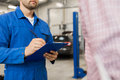 Auto Mechanic With Clipboard And Man At Car Shop Stock Images - 91388154