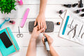 Closeup Shot Of A Woman In A Nail Salon Receiving A Manicure By A Beautician With Nail File. Woman Getting Nail Manicure Royalty Free Stock Photo - 91399375