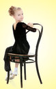 Slender Little Dancer Posing Near The Old Vienna Chair. Stock Photo - 91428950