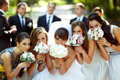 Girls And Bride Pose With Wedding Bouquets While Groom And Groom Royalty Free Stock Photography - 91447627