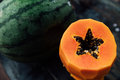 A Whole Watermelon And Peeled Cut Papaya Lie On A Wooden Table. Royalty Free Stock Image - 91450986