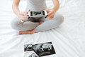 Pregnant Woman Taking Pictures Of Ultrasound Photos With Cell Phone Royalty Free Stock Images - 91452379