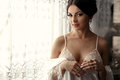 The Tenderness Bride Stands Near Window Stock Photo - 91456710