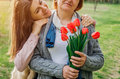 Daughter Gives Her Mother Tulips. Mother`s Day Present Stock Photo - 91469810