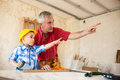 Grandfather And Grandson In Workshop Royalty Free Stock Photos - 91478078