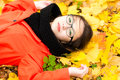 Attractive Girl With Glasses Lying On Leaves Stock Images - 91506094