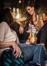 Two Fashion Woman Drinking Orange Alcohol Cocktail In The Pub Stock Photos - 91518813