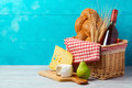 Basket With Wine Bottle, Bread And Cheese On Wooden Table. Jewish Holiday Shavuot Royalty Free Stock Photos - 91524008
