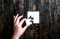 Hand With Missing Piece Of Jigsaw Stock Photos - 91533073