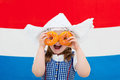 Dutch Girl With Orange Donuts And Netherlands Flag Stock Image - 91542261