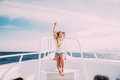 Woman Relax In Sunglasses On White Yacht In On Ocean Waves Stock Image - 91584171