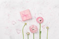 Gift Or Present Box And Beautiful Ranunculus Flower On White Table From Above For Wedding Mockup Or Greeting Card Flat Lay. Royalty Free Stock Image - 91640436