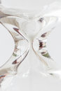 Detail Of Flowing White Sand Crystal In Hourglass On White Backg Stock Photography - 91640732