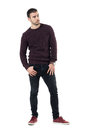 Serious Confident Macho Casual Man Wearing Maroon Sweater Looking Away. Stock Images - 91647434