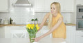 Woman Arranging Vase With Flowers On Table Stock Photo - 91651360