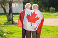 Old Couple Wrapped In Flag. Royalty Free Stock Images - 91666549