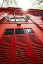 Vintage Red Building With Wooden Shutters Stock Images - 91667864