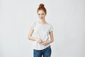 Portrait Of Smart Redhead Girl Flirting On Camera Feeling Insecure Yet To Meet Her Boyfriend. Weating Jeans And A Bun Royalty Free Stock Image - 91708306